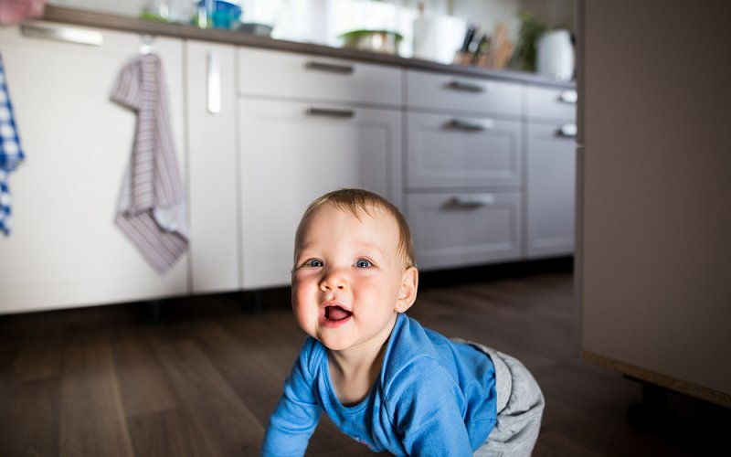baby playing pest control image